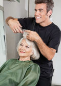 Hairstylist Cutting Client's Hair In Parlor — Stock Photo