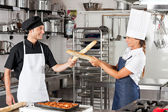 Chefs Fighting With Bread Loafs — Foto de Stock