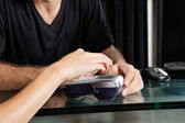Customer Paying With Mobilephone Over Electronic Reader — Foto Stock