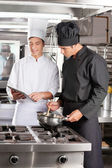 Young Chefs With Digital Tablet Preparing Food — Stock Photo