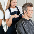 Stock Photo: Hairstylist Giving Haircut To Client At Salon