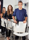 Confident Hairdressers With Hairdryer And Scissors In Salon — Stock Photo