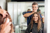 Hairstylist Setting Client's Hair While Looking At Mirror — Stock Photo