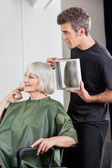 Hairstylist Showing Finished Haircut To Customer — Stock Photo