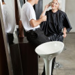 Hairstylist Listening To Female Client — Stock Photo