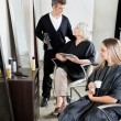 Hairdresser With Client's In Salon — Stock Photo