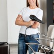Hairdresser Holding Hair Dryer At Salon - Stock Photo