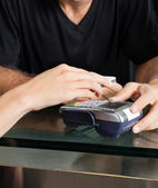 Customer Paying With Mobilephone Over Electronic Reader At Salon — Stock Photo