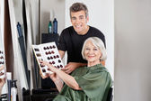 Client With Hairstylist Holding Color Catalog — Stock Photo