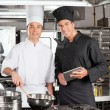 Happy Chefs With Digital Tablet Cooking Food — Stock Photo