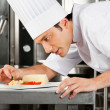 Chef Garnishing Dish — Stock Photo #21928345