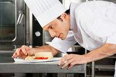 Chef Garnishing Dish — Stock Photo