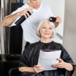 Woman Getting Her Hair Done In Salon — Stock Photo