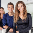 Happy Hairdressers Standing In Salon — Stock Photo