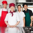 Happy Chefs Standing Together In Kitchen — Stock Photo #21933945