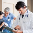 Male Doctor Using Digital Tablet — Stock Photo