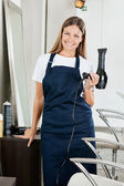 Hairstylist With Hairdryer At Parlor — Stock Photo