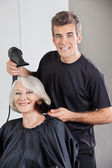 Hairstylist With Dryer Setting Up Woman's Hair — Stock Photo
