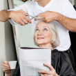 Senior Woman Having Haircut At Salon — Stock Photo