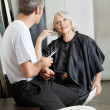 Hairdresser Listening To Female Client — Stock Photo