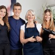 Confident Hairdressers Standing Together - Stock Photo