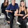 Stock Photo: Confident Hairstylists sitting In Salon