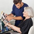 Customer And Hairstylist Selecting Hair Color — Stock Photo #21988383