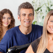 Male And Female Hairstylists At Salon - Stock Photo