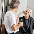 Client Instructing Hairdresser In Salon — Stock Photo #21988537