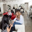 Customer Having Manicure At Parlor - Stock Photo