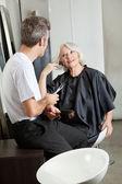 Hairdresser Listening To Female Client — Stock Photo