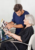 Customer And Hairstylist Selecting Hair Color — Stock Photo