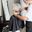 Stock Photo: WomGetting Hair Cut In Beauty Parlor