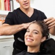 Royalty-Free Stock Photo: Female Client Having Her Hair Washed In Salon
