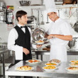 Chef Giving Pasta Dish To Waiter — Stock Photo #22161077