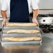 Royalty-Free Stock Photo: Male Chef Presenting Bread Loafs