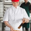 Chef Preparing Chocolate Roll — Stock Photo
