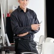 Stock Photo: Male Hairstylist With Scissors At Salon
