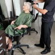 Stock Photo: Hairdresser Straightening Senior Woman's Hair