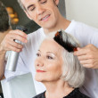 Royalty-Free Stock Photo: Hairdresser Setting Up Client\'s Hair