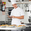 Happy Chef With Digital Tablet Checking List Of Pastas — Stockfoto