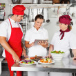 Chefs Using Digital Computer In Kitchen — Stock Photo