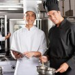 Happy Chefs Cooking Together - Stock Photo