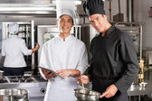 Happy Chefs Cooking Together — Stock Photo
