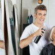 Hairdresser Styling Client's Hair At Salon — Stock Photo