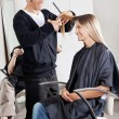 Stock Photo: Hairstylist Cutting Customer's Hair In Parlor