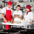 Chefs Using Digital Tablet In Kitchen — Stock Photo #22221007