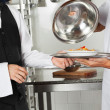Chef Giving Pasta Dish To Waiter — Stock Photo #22221467