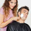 Scared Man Being Shaved By Female Barber - Stock Photo