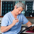 Stock Photo: Medical Professional Reading Document